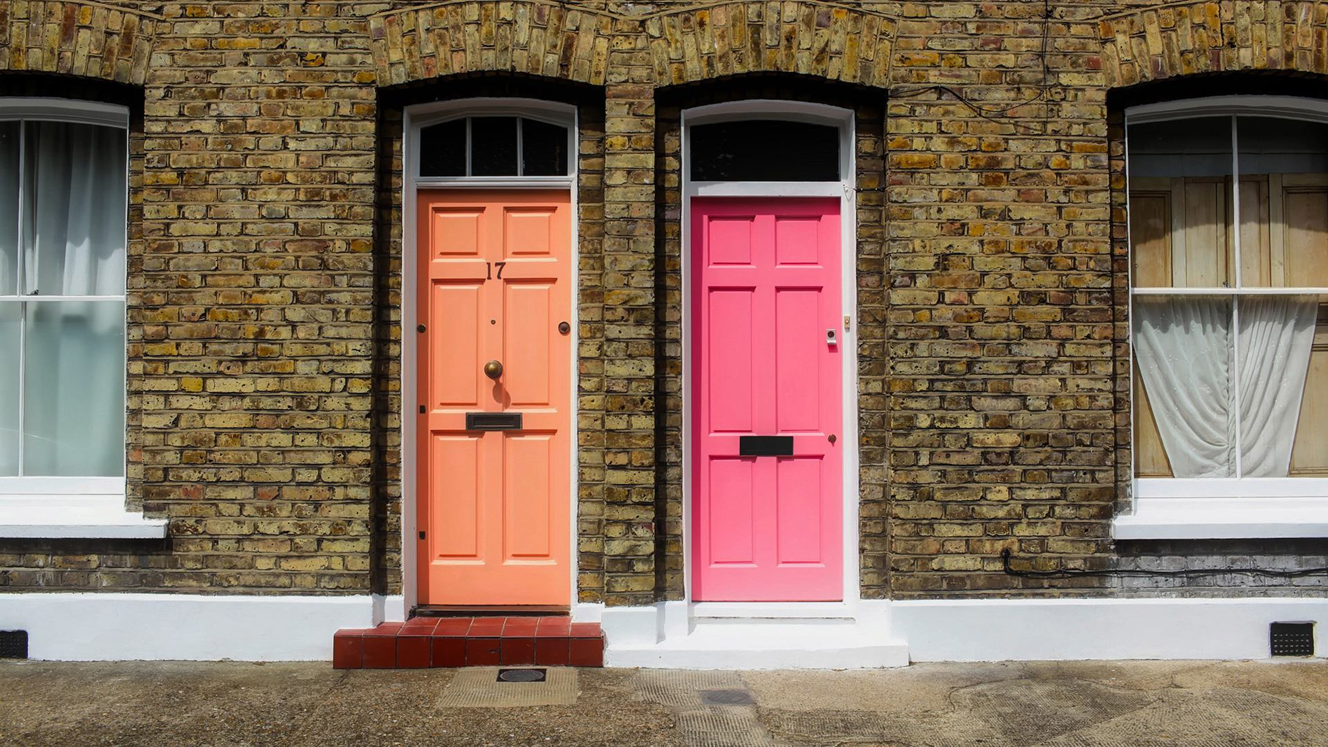 Terraced houses with orange and pink doors