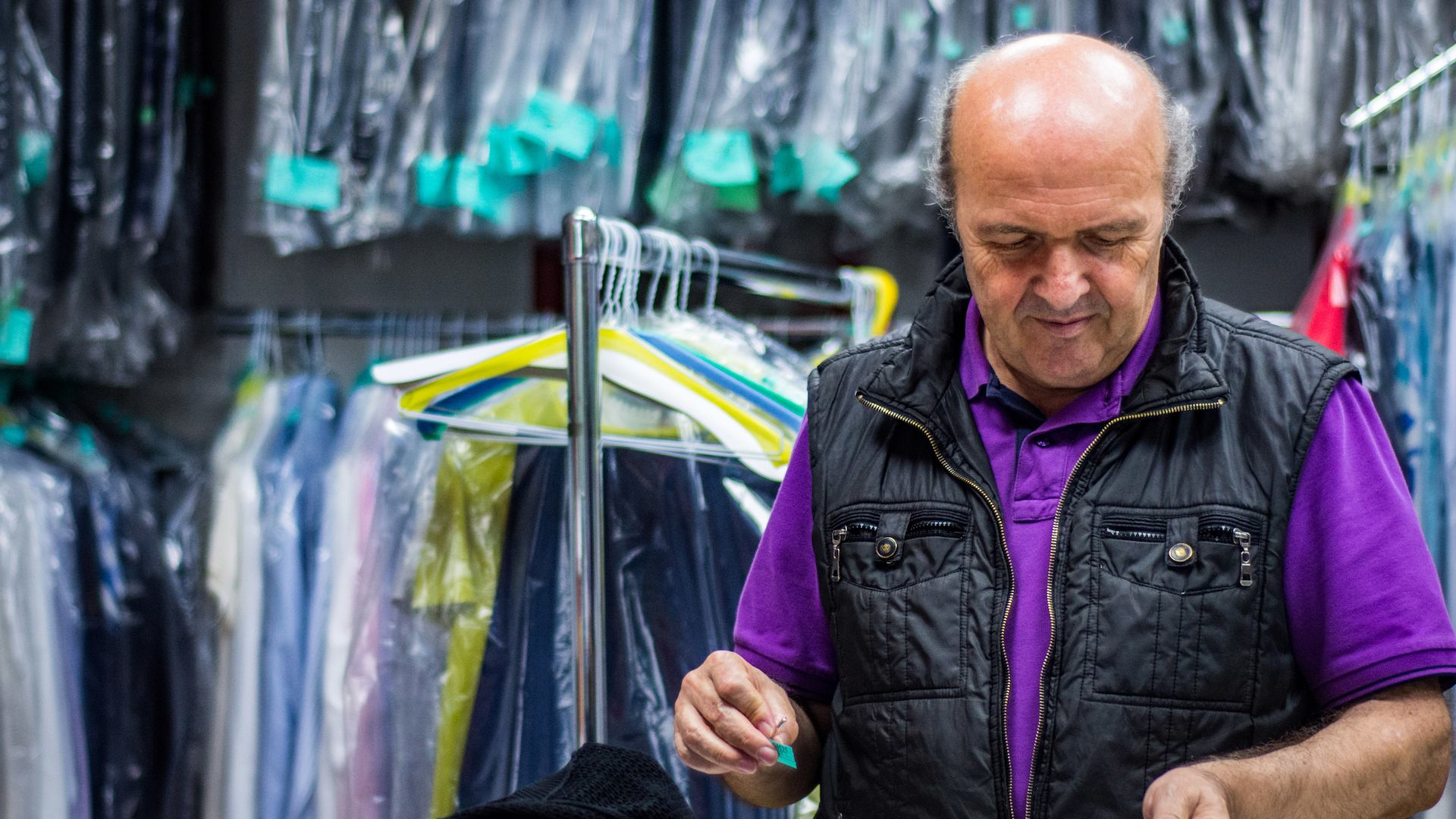 Older worker in dry cleaners