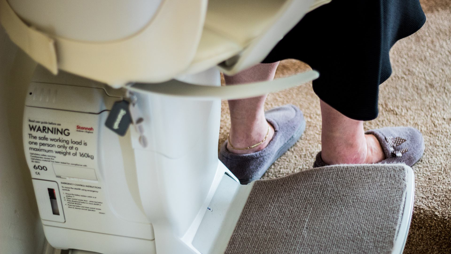 Older lady using a stair lift