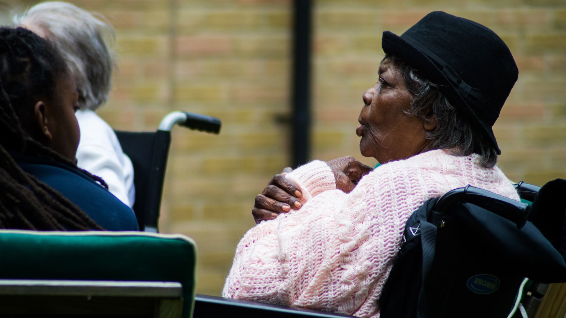 Older black woman sitting in wheelchair