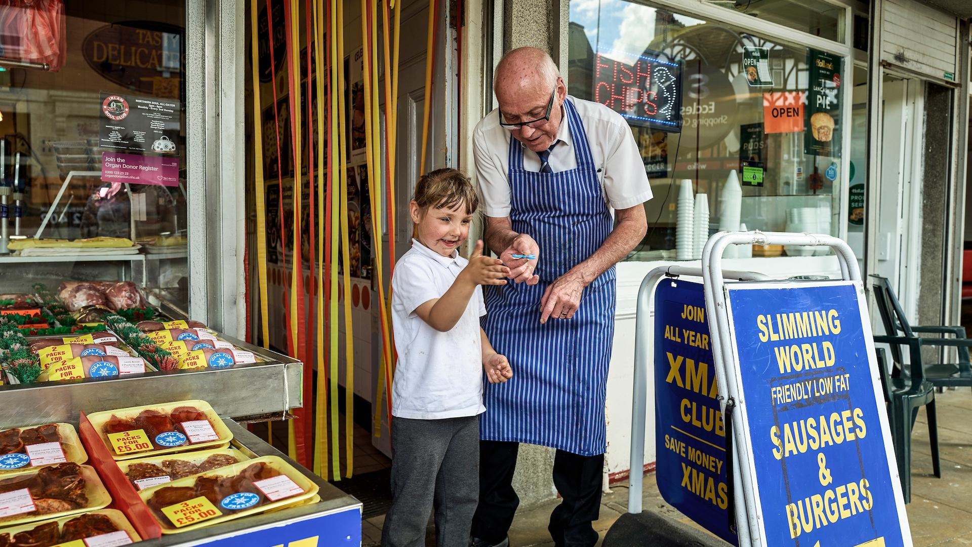 Butcher with young boy
