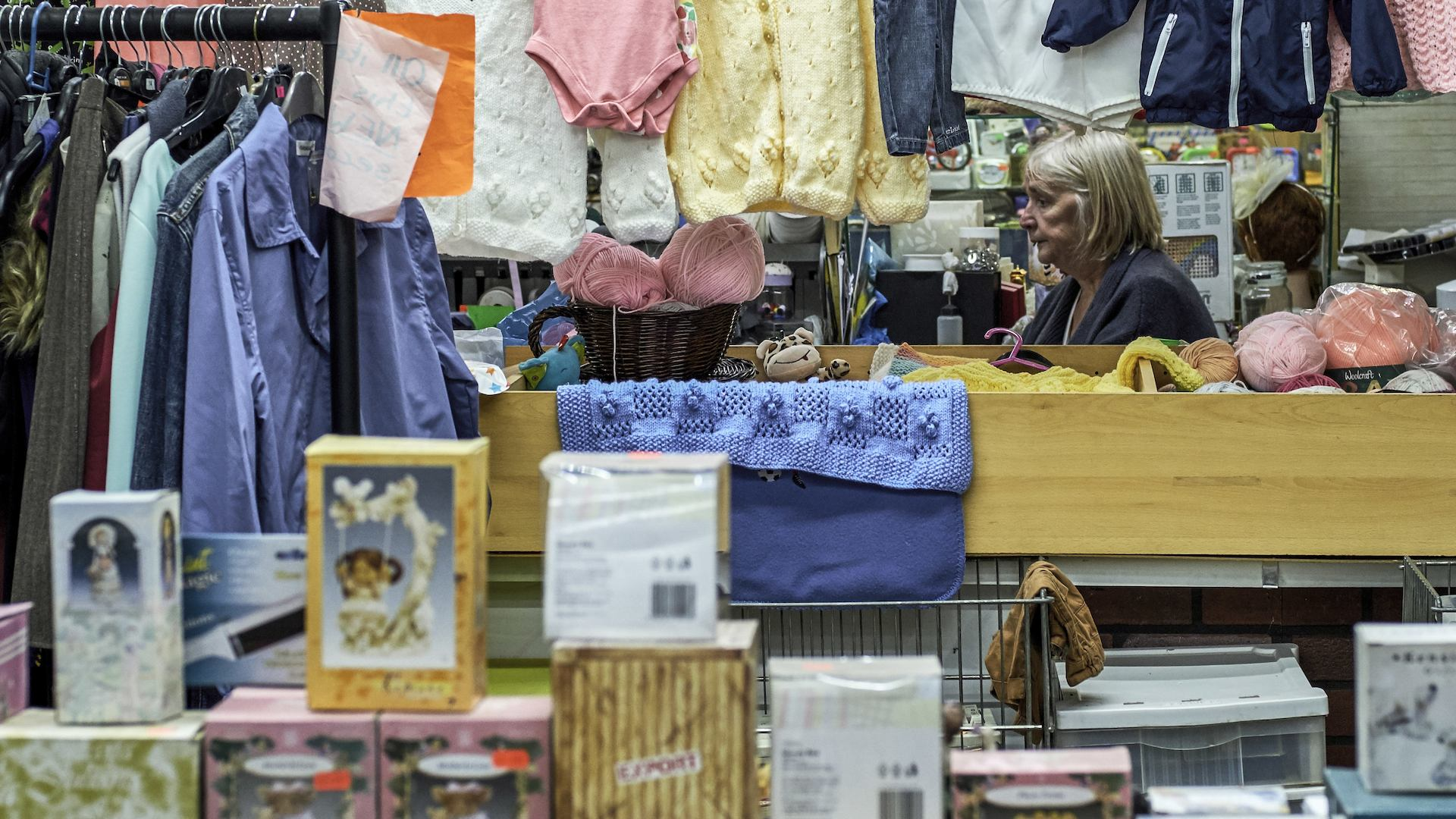 Woman shopping in Eccles, Greater Manchester