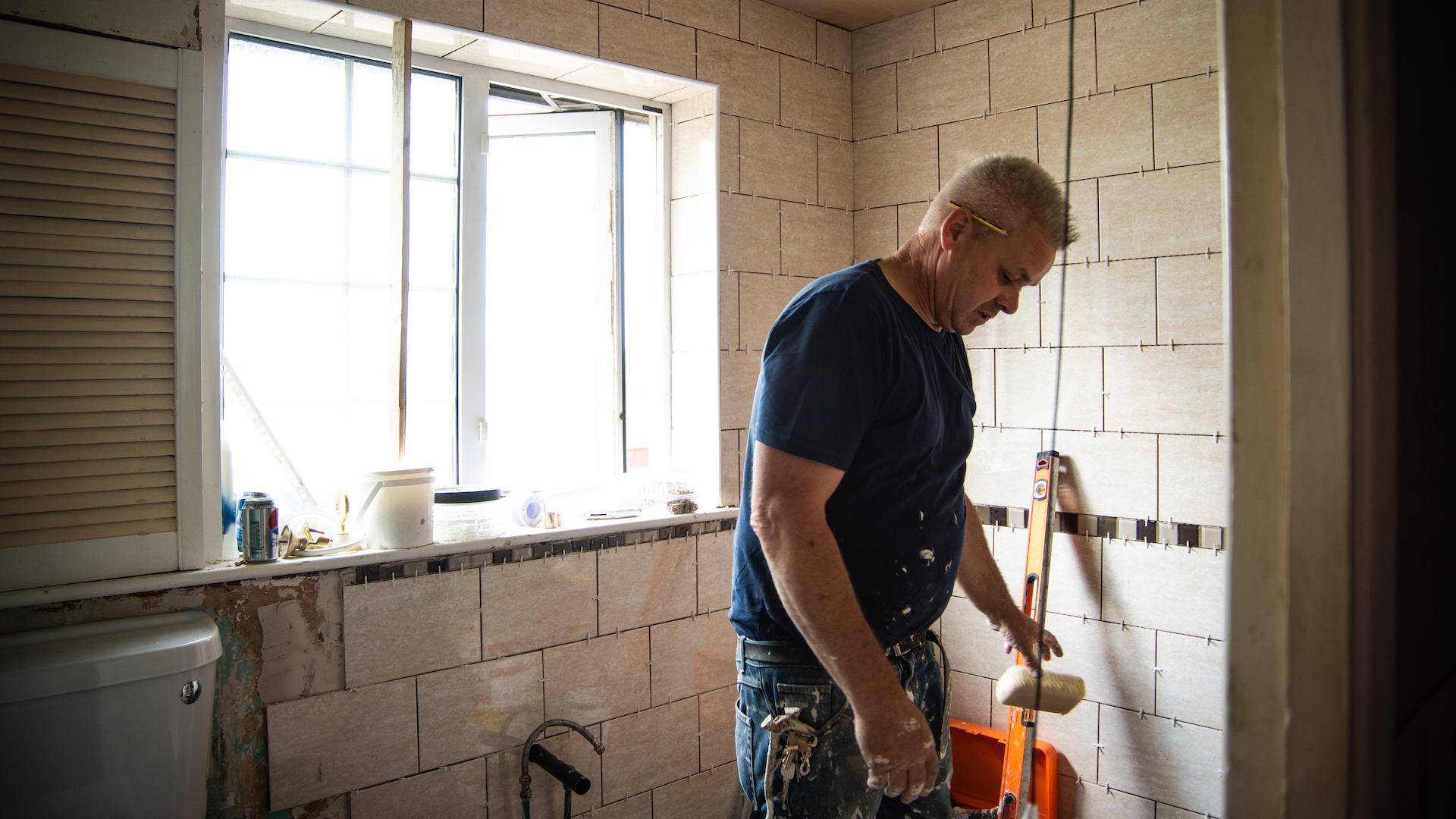 Worker making adaptations to a bathroom.