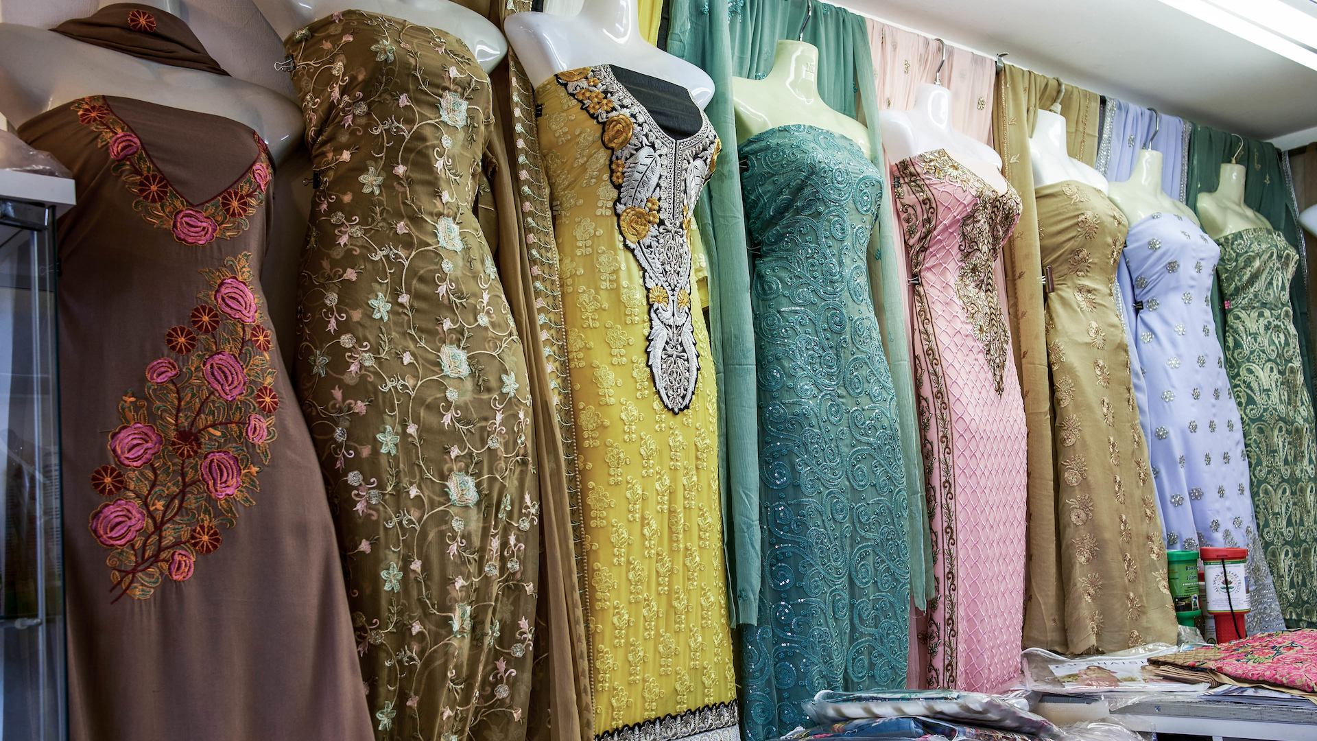 Collection of traditional East Asian dresses in a shop