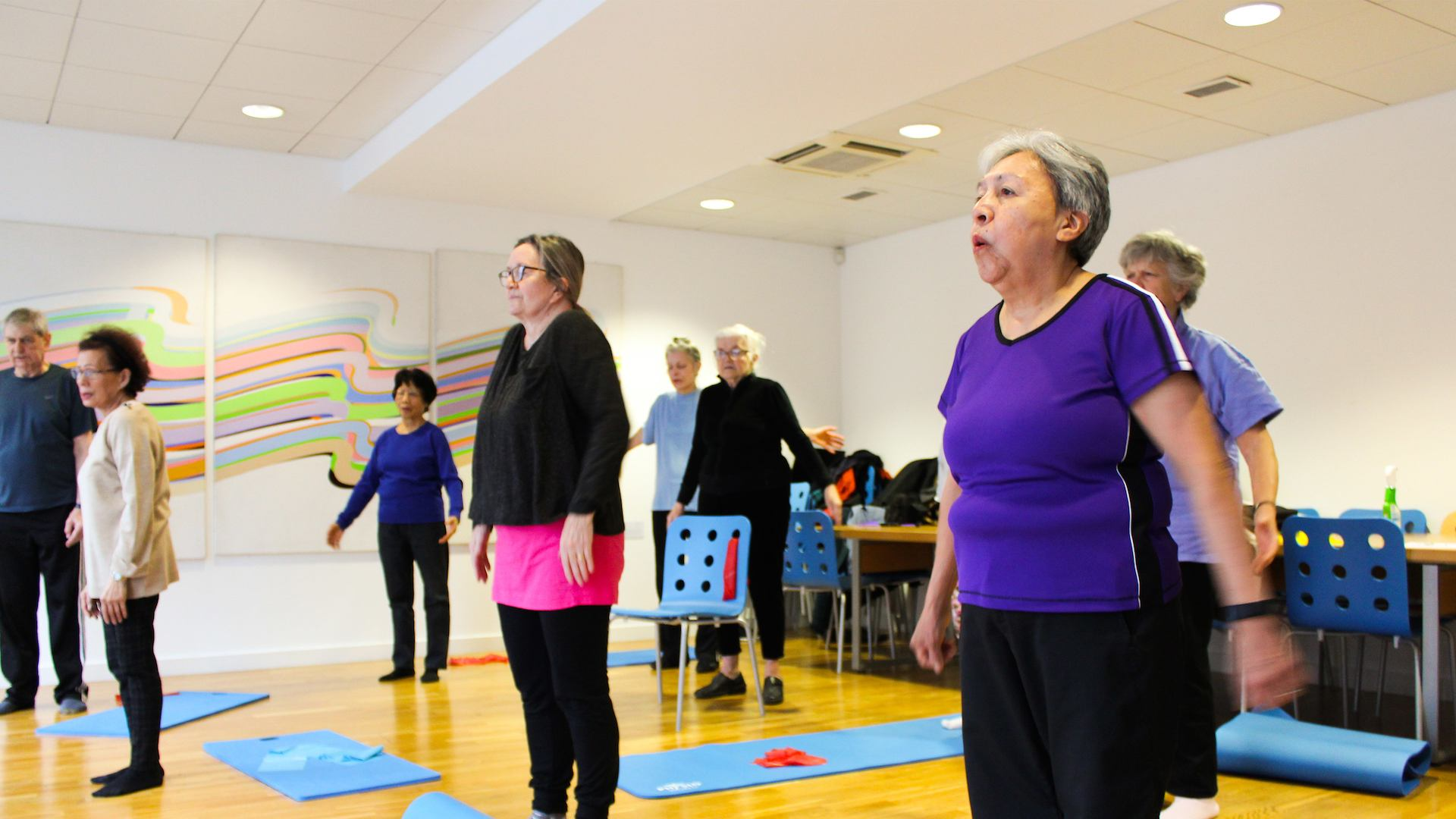 Older people in yoga class