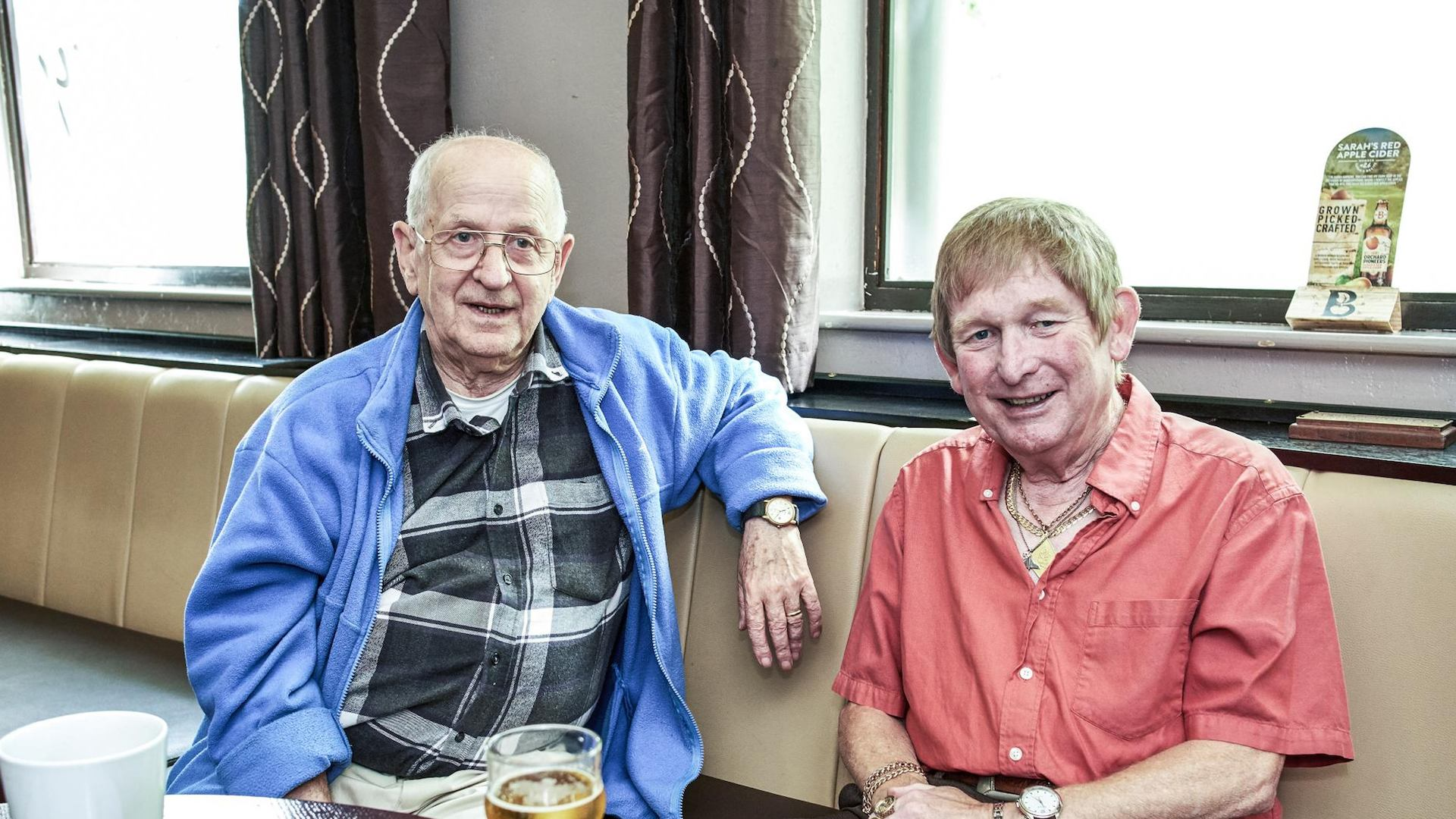 Two older men in a pub