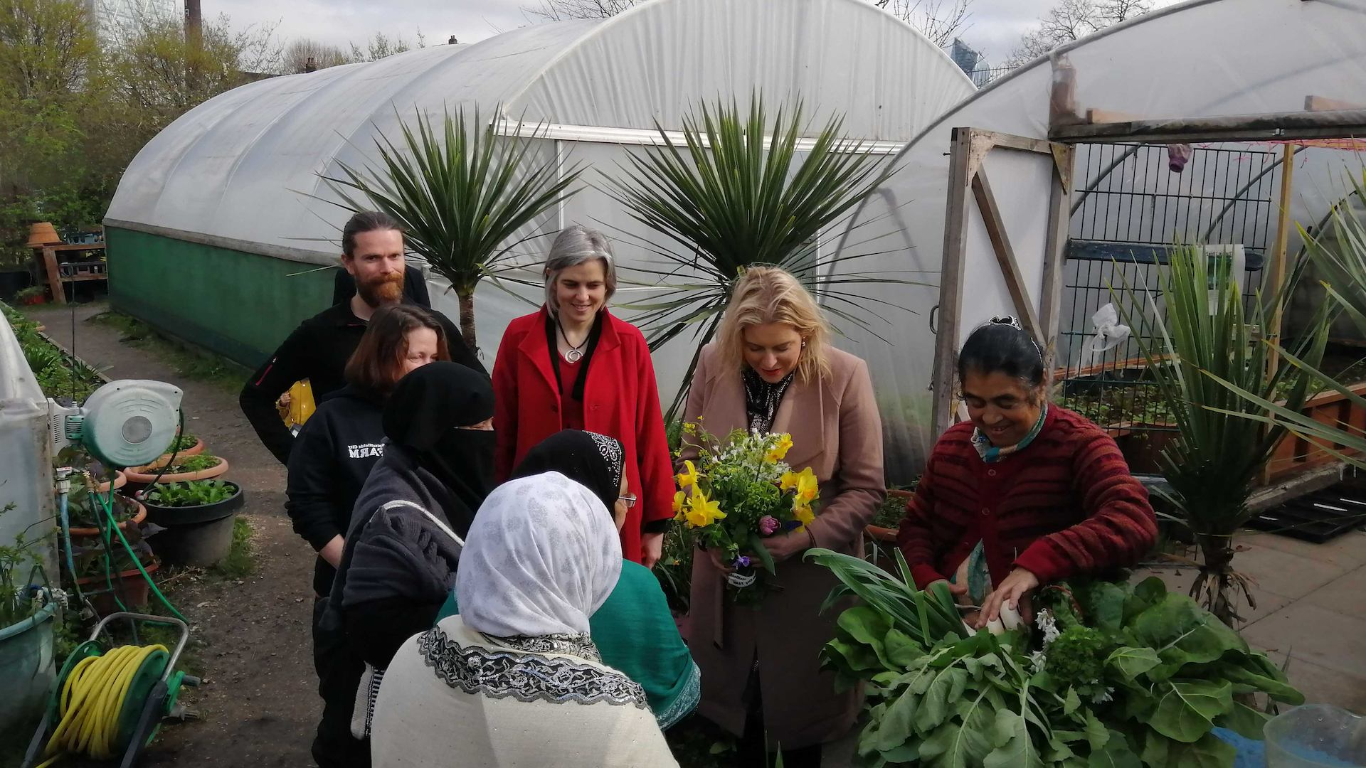 Volunteers in an allotment with Mims Davies