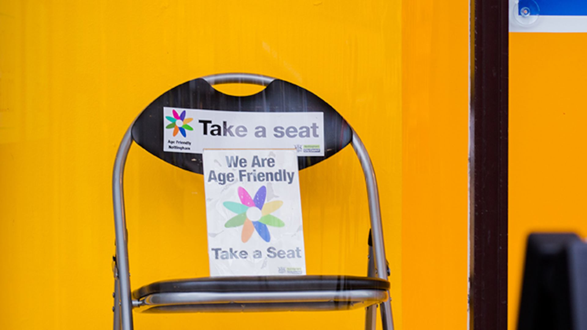 Chair with take a seat sign