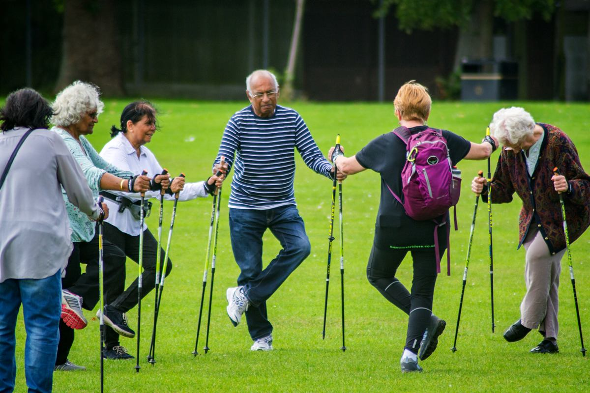 Group of people 'Nordic' walking in the park