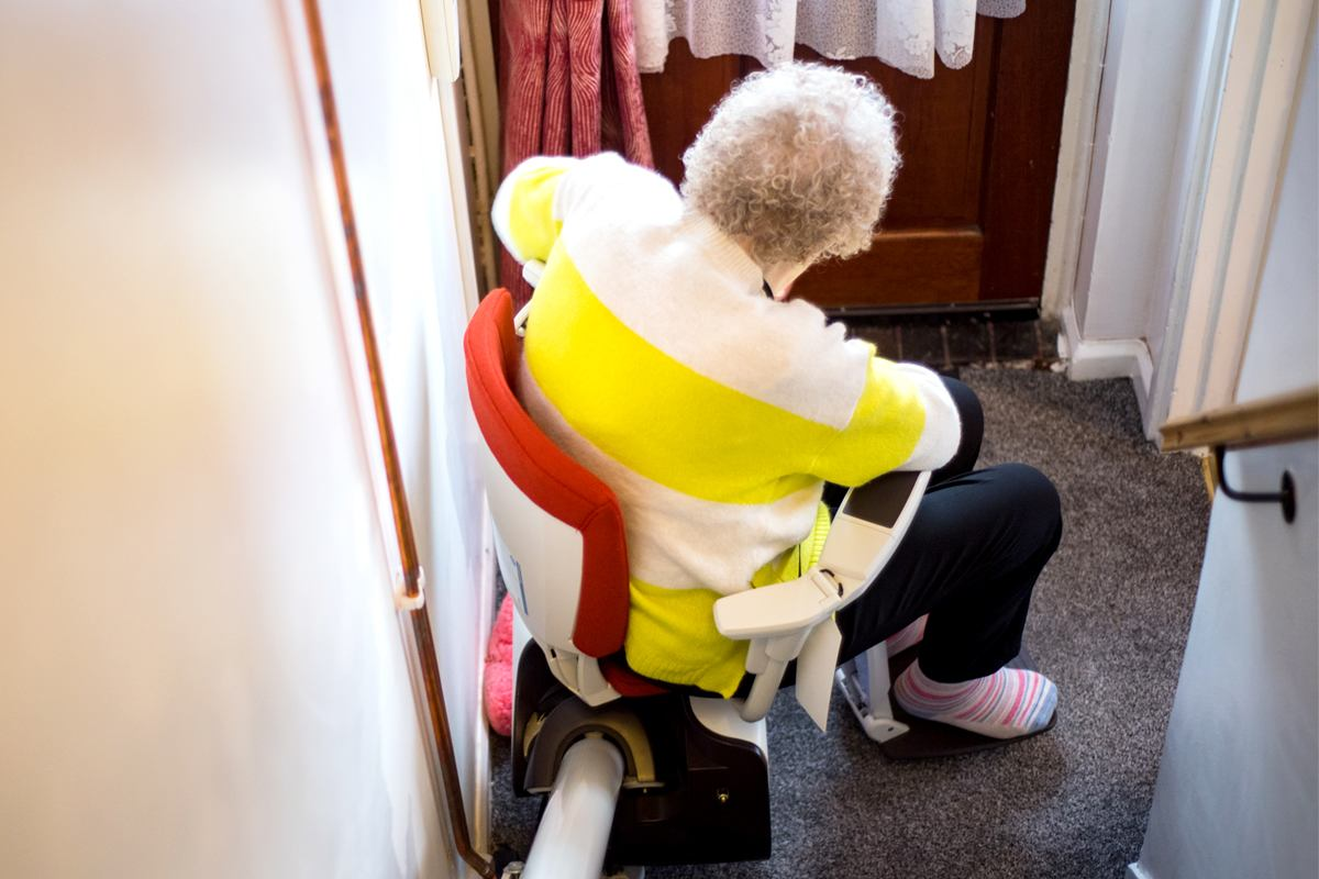 Older woman using a stairlift