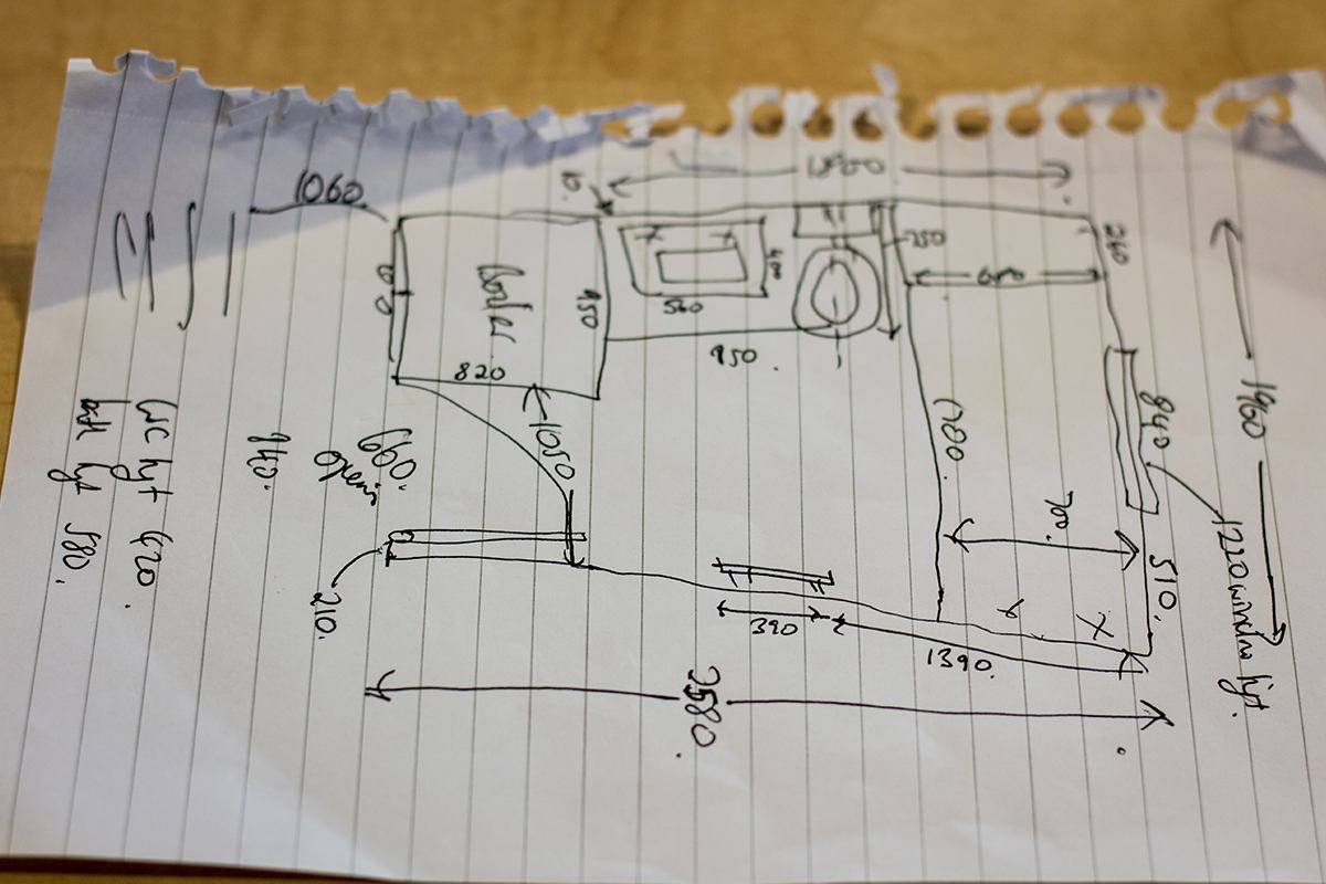 Hand drawn plans on a piece of paper.