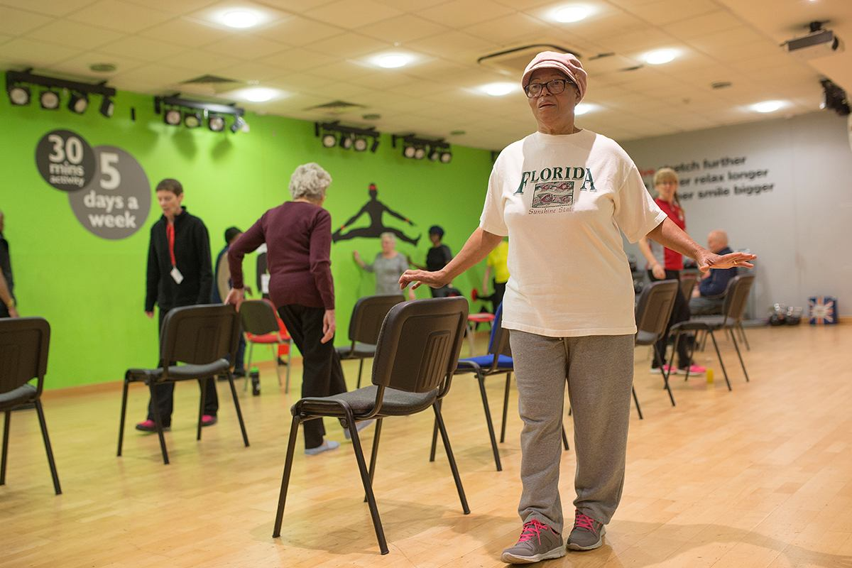 Elderly people doing a strength and balance class.