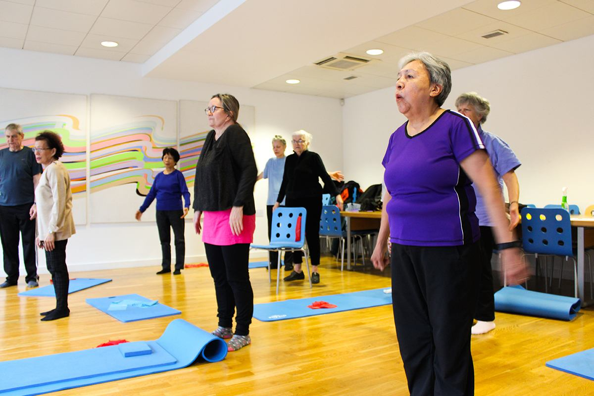 Older people in a yoga class
