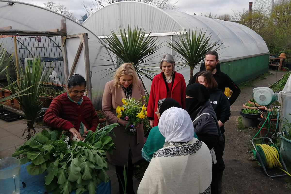 Anna Dixon, Mims Davis and a Sustain volunteer around a garden allotment