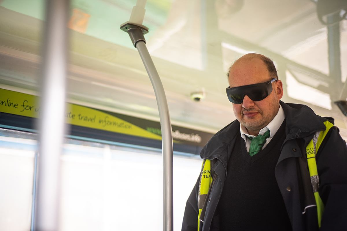 Man wearing visual impairment glassses