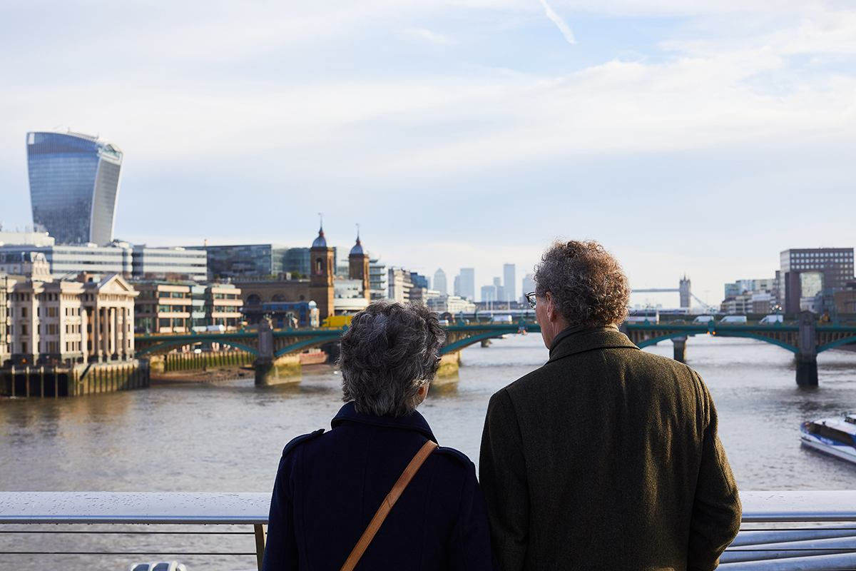 Older couple looking onto a river