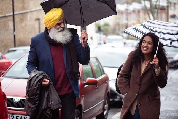 Older sikh man walking with younger woman