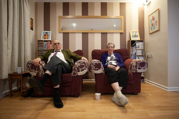 Older couple sitting at home