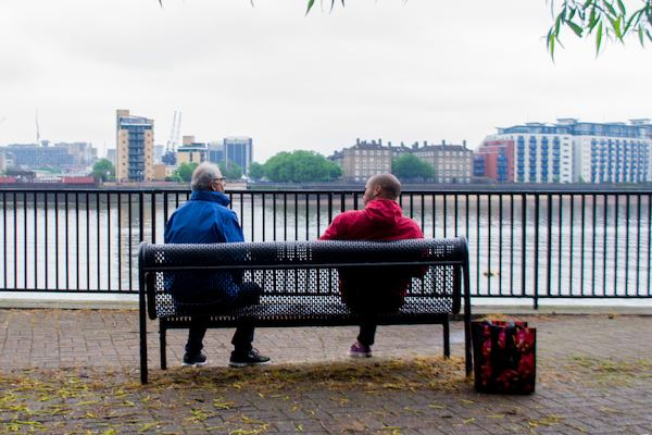 Two men sitting on a bench, Greenwich