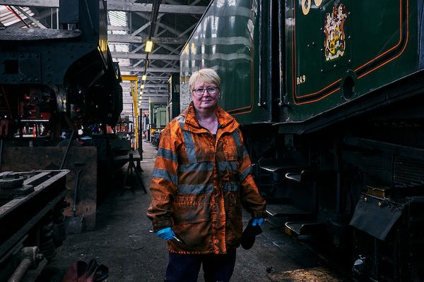 Older woman standing by railway