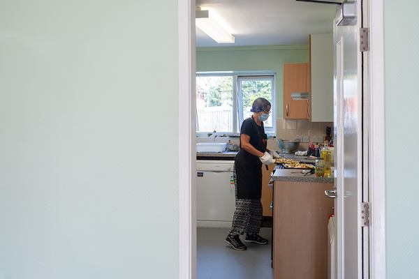 Older woman in community kitchen